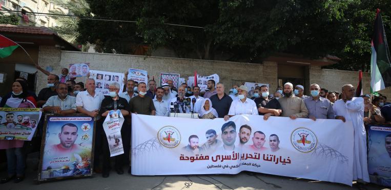 حركة الجهاد الاسلامي تنظم وقفة تضامنية مع الأسري الذين انتزعوا حريتهم وأعيد اعقالهم
